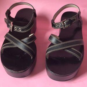 Black Prada leather platform